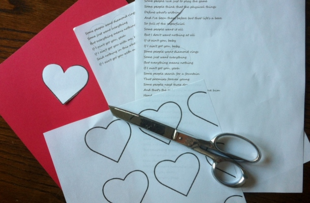 Cutting out the lyrics in heart shapes (note the use of the heart template!)