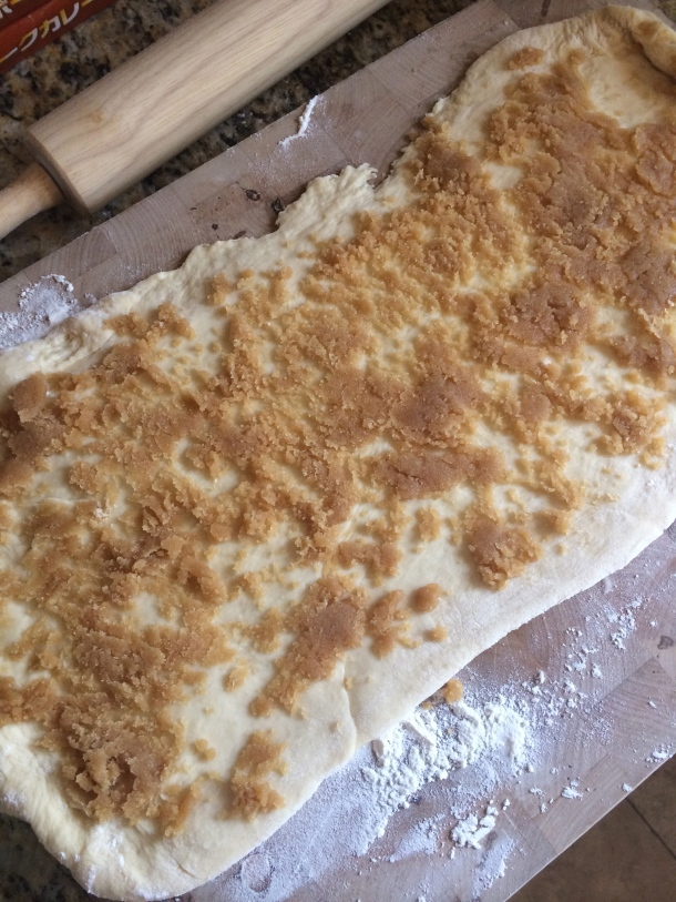 Rolling out the dough and spreading the brown sugar and praline mix. Looking good!